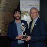 Andrew Huxley of the TT Club presenting Joe with his award