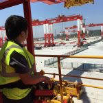 An operator controls STS cranes from a safe distance at Yangshan