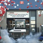 Factory workers looked on as balloons were released and the tractor was unveiled