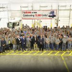 Employees and guests gathered to watch the final assembly of the truck