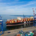 MSC Gülsün preparing to dock in the shadow of Liebherr cranes
