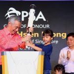 Prime Minister of Singapore, Lee Hsien Loong, placing a torch on the grounds of Tuas Port
